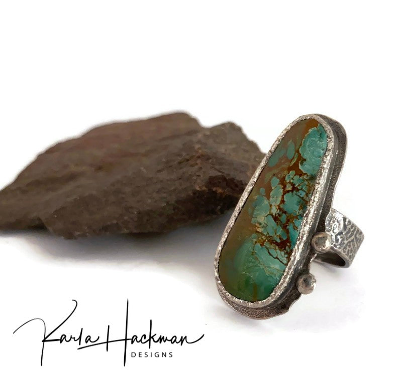 Sterling silver, hand-fabricated ring with a leaf skeleton textured bank highlights a gorgeous piece of old Royston Ranch Turquoise.  Ring features a brushed and organic shaped bezel edge and seat.