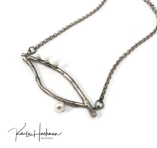 Apple branches from Karla's garden are picked and cast in sterling silver. Once cast, pendant is fabricated, oxidized to highlight the branch texture, and then 3 mm and 6 mm white freshwater pearls are mounted. Sterling silver chain.