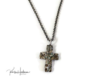 he cross, a Karla Hackman Designs original, was first hand-carved in wax and then cast in fine silver. Using Keum Boo, an ancient Korean gilding technique, thin layers of 24 solid gold were then fused to the cross.   Combining my love of wax carving with this ancient jewelry technique resulted in this beautiful one-of-a-kind piece of jewelry.  The piece is then finished with heavy oxidation to highlight the rich gold luster. The reverse side, is fine silver highlighted with oxidation.