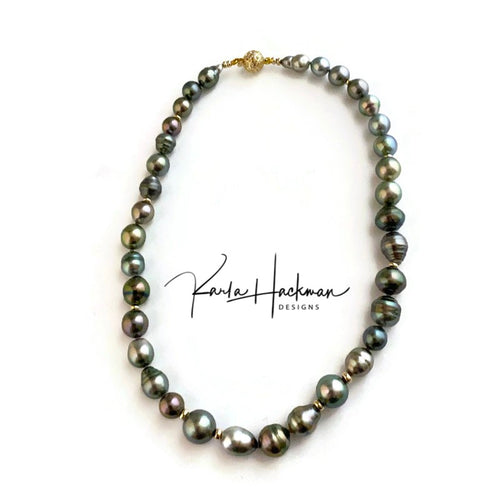 This beautiful and one-of-a-kind strand of pastel highlighted, baroque and round Tahitian Pearls are hand knotted on grey silk and accented with 14 karat gold beads and an open 14 karat gold filigree clasp. These pearls have a lot of blue, purple, and grey hues with touches of green and pink.