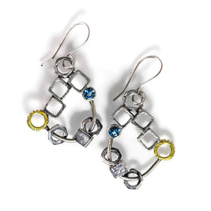 These chandelier earrings are a mix of sterling silver cubes, circles, and washers, and one 18 karat gold offset circle and then adorned with a 4mm garnet or topaz. Cubes are hammered and textured inside and out, and the silver is given an oxidized finish.