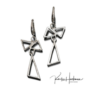 Handmade earrings combine 3 sterling silver triangles in a sculptural design, and they are given a bright hammered finish.