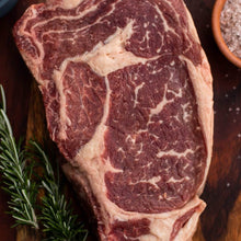 Load image into Gallery viewer, Close up of beef ribeye steak
