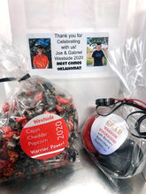 Load image into Gallery viewer, Parade Goodie Bags with Cajun Cheddar Popcorn and Macarons with Blackberry Buttercream and Raspberry Jam in School Colors