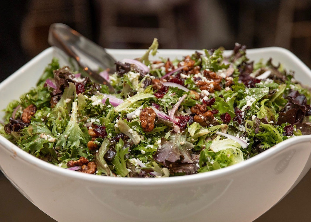 Our Signature Salad with Baby Greens, Dried Cranberries, Feta Cheese, Red Onions, Candied Walnuts, & Raisin Port Wine Vinaigrette