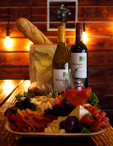 Charcuterie Board Delivery with assorted meats and cheeses and marinated vegetables and Wine Delivered with Baguette for Happy Hour in Omaha, Nebraska