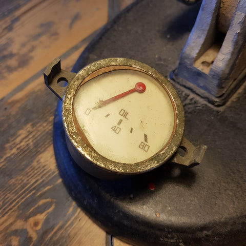 Oil pressure gauge (white face)