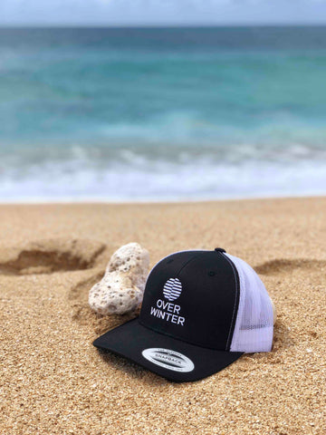 Black and white hat on beach in Hawaii