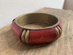 Red wooden and gold tone bracelet, by