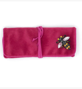 Pink jewellery wrap with bee brooch