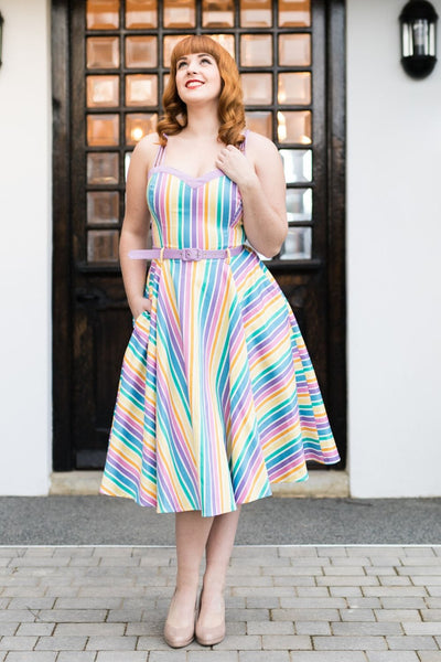 Girl in 1950s dress in rainbow colours