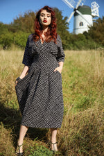 1940s Dress in monochrome print with sleeves and pockets