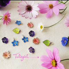 Talisgirl Charms Spring flower charms in sterling silver and traditional fired glass enamels.