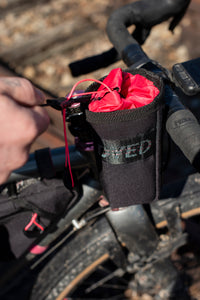 Dyed in the Wool custom Stem bags shown attached to an adventure bikepacking bike.