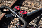Load image into Gallery viewer, Dyed in the Wool custom Stem bags shown attached to an adventure bikepacking bike.