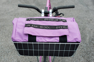 Dyed in the wool bike basket bag for Wald basket shown in X-pac lilic and Cordura black, Fitted to a fixed gear bike.