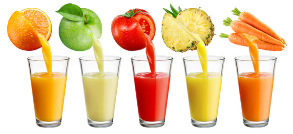 Cold Press Juice in Glasses Orange Apple Tomato Pineapple Carrot