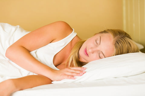 sleeping woman infrared sauna benefits blonde