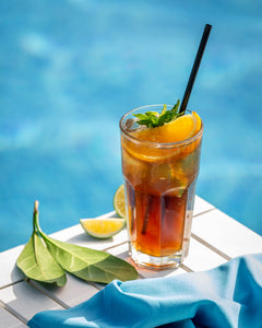 Close up of lemon mango mocktail by the pool
