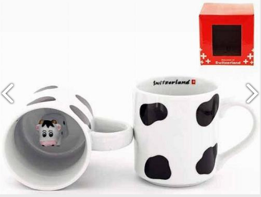 BLACK AND WHITE MUG WITH COW HEAD AT BOTTOM