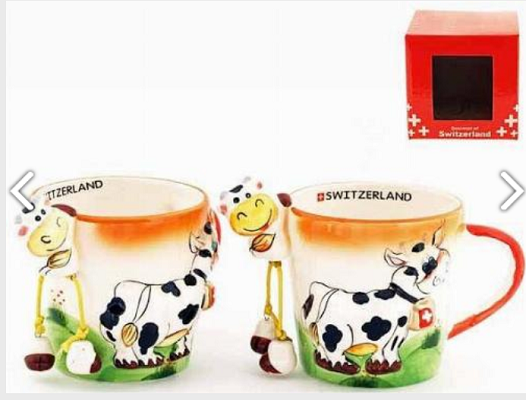 COLOURFUL MUG WITH COW HANGING