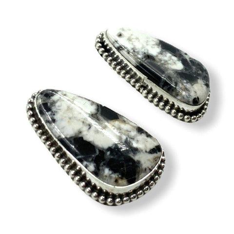 SOLD Large  White Buffalo Ear.-Fancy Bezel