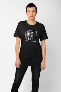 Gay pride shirt featuring a mighty message. The 'Every Gay is a Gift' gay pride shirt from Rainbow Rave Shop. Black shirt with white lettering.