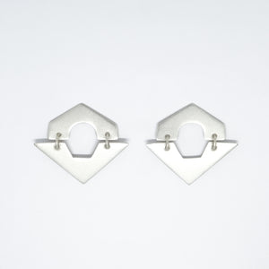 Sterling silver geometrical earrings designed by Amy Torello.