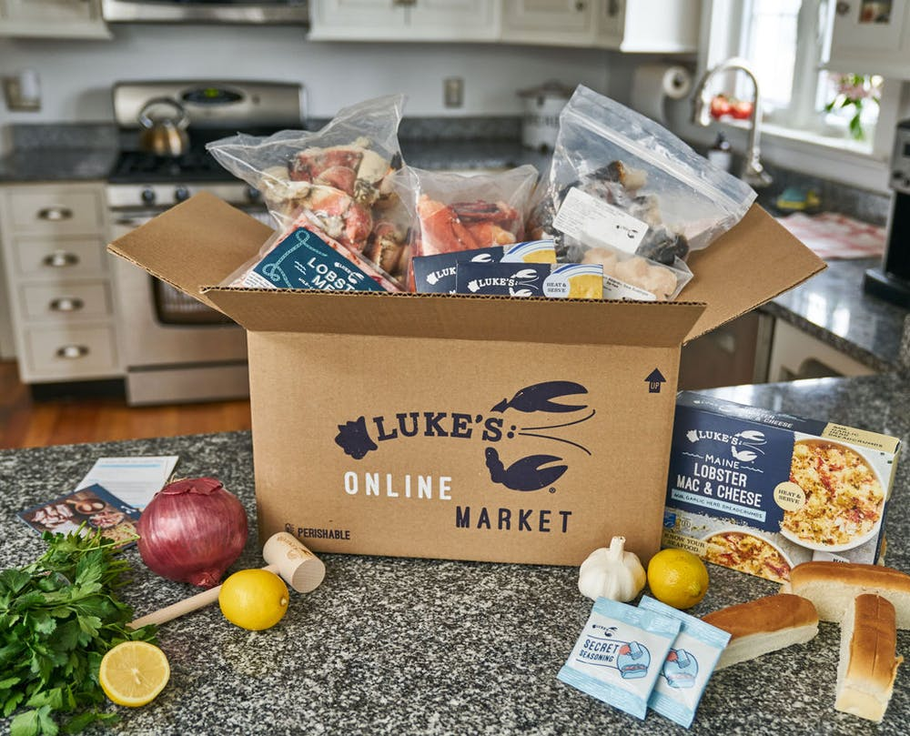 box filled with many luke's lobster products