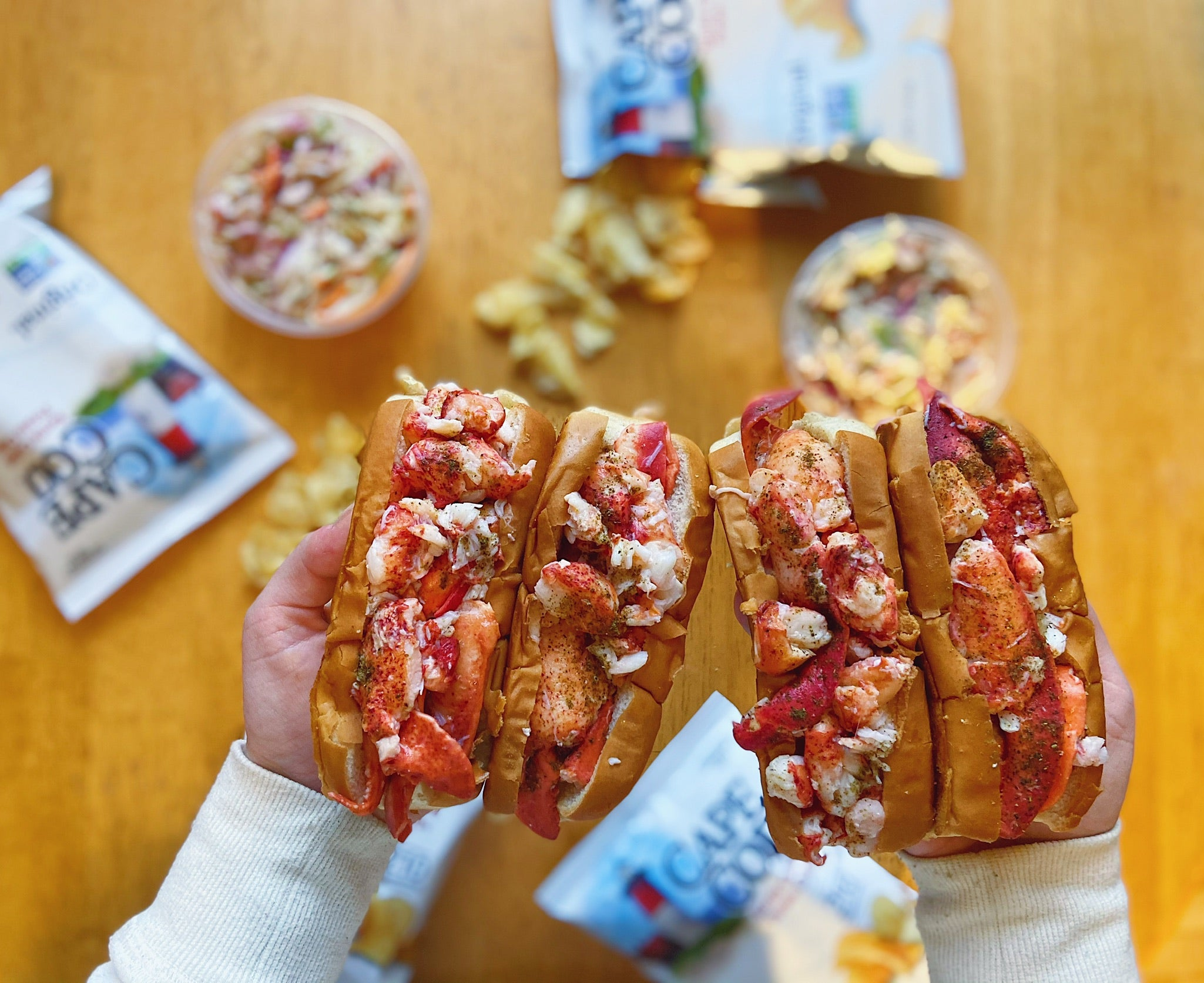 4 lobster rolls with chips and drink