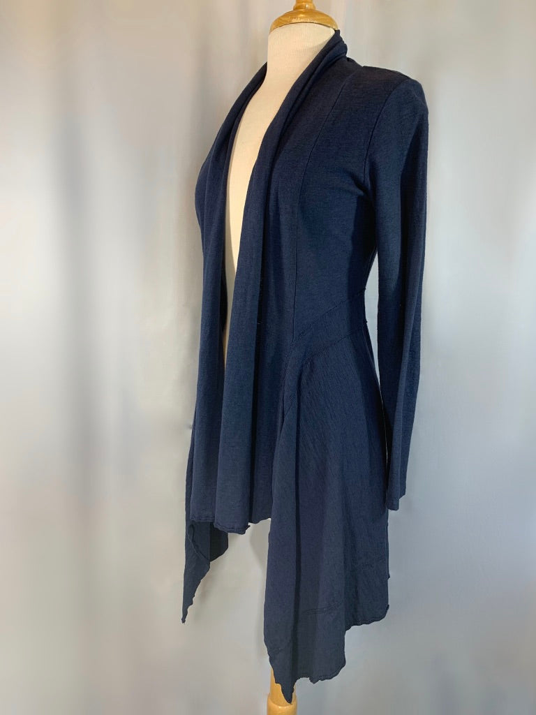 A fan favorite fabric! Pre-shrunk cotton blended with linen is summers best friend. Weighty yet breathable, this fitted, open jacket will stand the test of time.   Cut + dyed in San Francisco Machine wash 50% cotton 50% linen Scoop neckline short sleeves Flattering tunic length