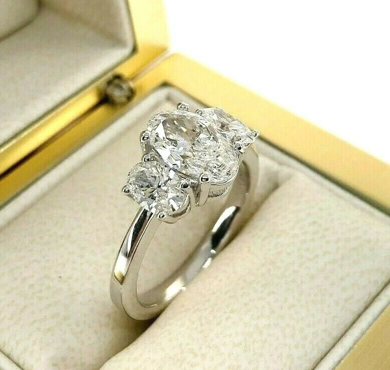 2.34 Carats 3 Oval Diamond Engagement Ring 1.50 Carat GIA D Color Center Stone