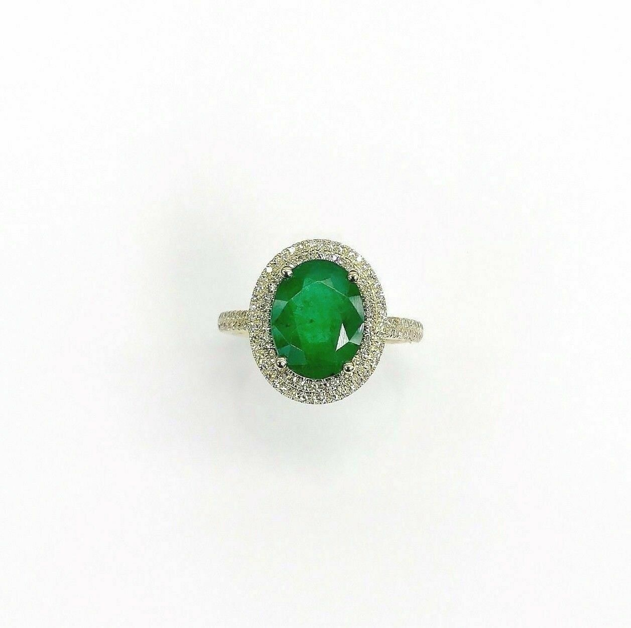 2.95 Carats t.w. Diamond and Emerald Halo Ring Emerald is 2.60 Carats May Stone