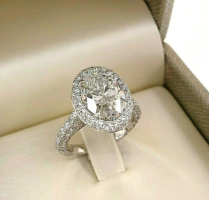 5.46 Carats t.w. Oval Cut Diamond Puffed Halo 3 Sided Pave Engagement Ring Plat