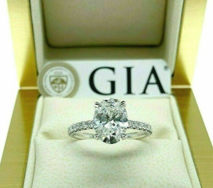 2.39 Carats t.w. Oval GIA F SI1 Under Halo Hand Made Engagement Ring 18K Gold