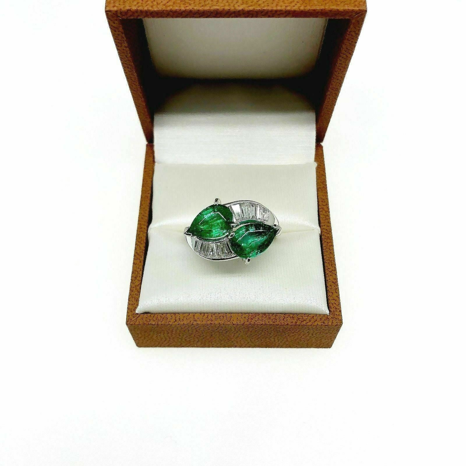 3.99 Carats t.w. Diamond and Emerald Ring Bypass Celebration Ring Platinum