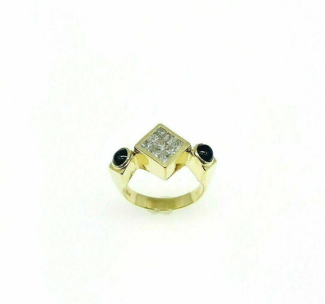 1.42 Carats t.w. Invisible Set Diamond and Cabochon Sapphire Ring 18K YellowGold
