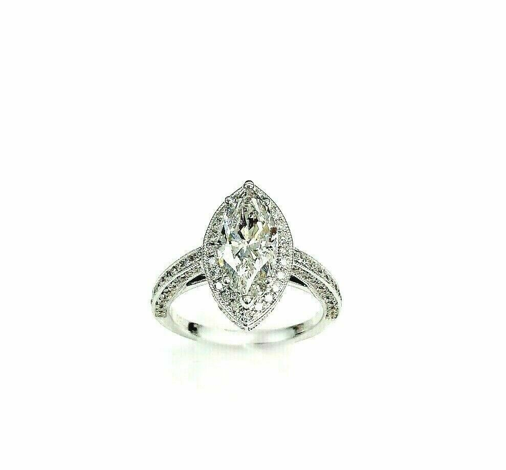 3.16 Carats t.w. Marquise Halo 3 Sided Diamond Engagement Ring 2.01 G SI1 Center