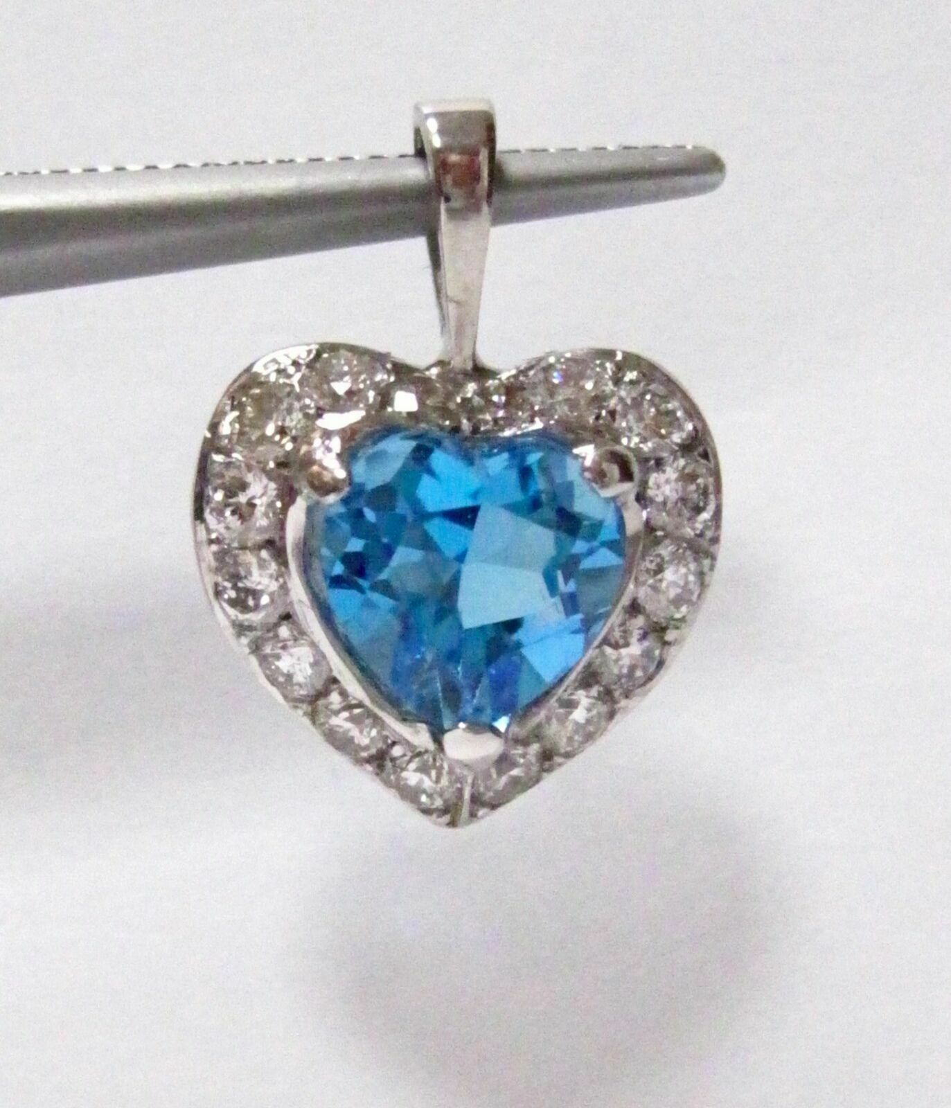 3.26 TCW Natural Heart Shape Blue Topaz & Diamond Pendant G SI1 14k White Gold