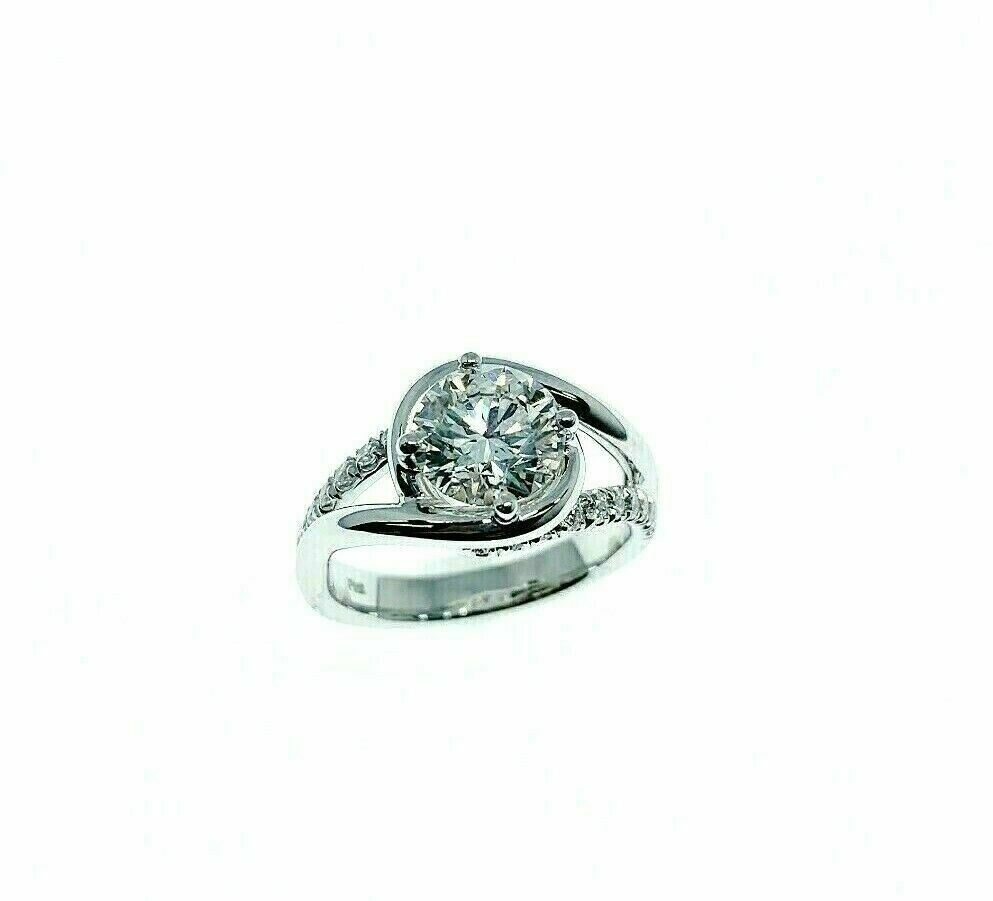1.55 Carats tw Round GIA E VS2 3EX Cut Bypass Platinum Hand Made Engagement Ring