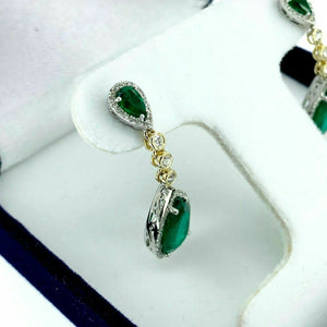 3.95 Carats t.w. Emerald and Diamond Dangle Earrings Emeralds are 3.50 Carats tw