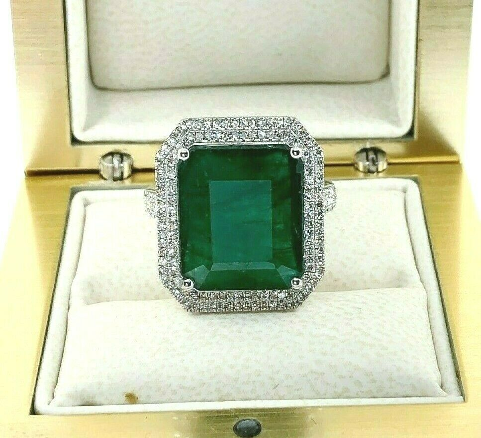 8.77 Carats t.w. Diamond and Emerald Halo Pave Set Ring Emerald is 8.32 Carats