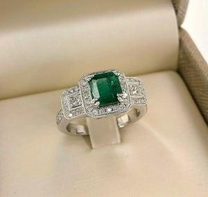 2.09 Carats t.w. Diamond and Emerald Halo Wedding Ring Emerald is 1.44 Carats