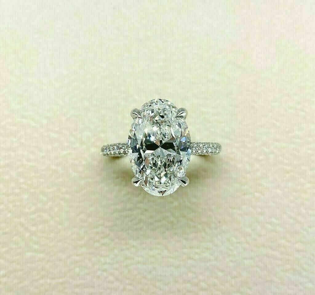 5.34 Carats t.w. F VS2 Oval Cut Diamond Under Halo Engagement Ring 4.50 Center