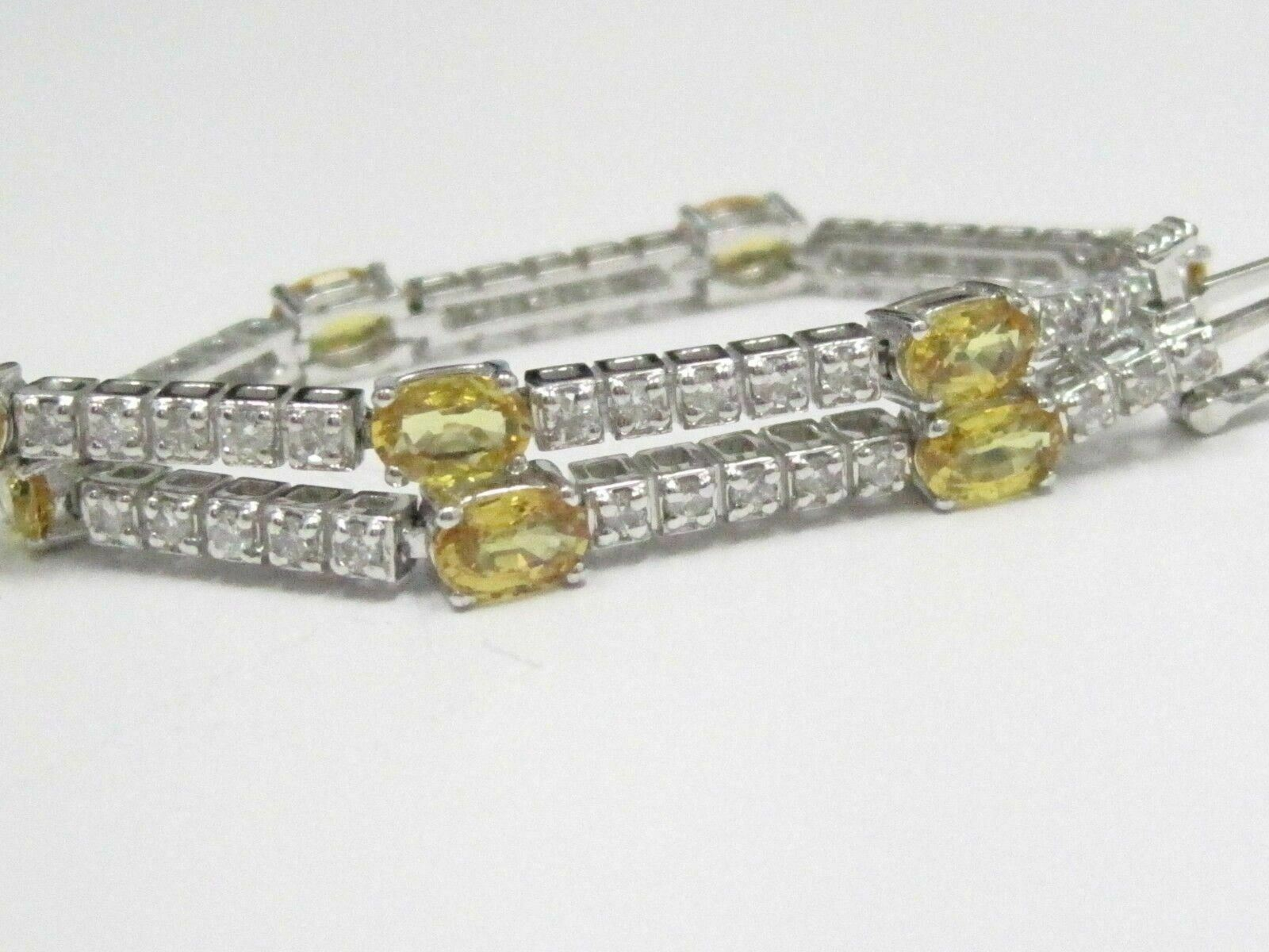 6.08 TCW Round Brilliant Diamonds and Oval Yellow Sapphire Bracelet 14kt WG
