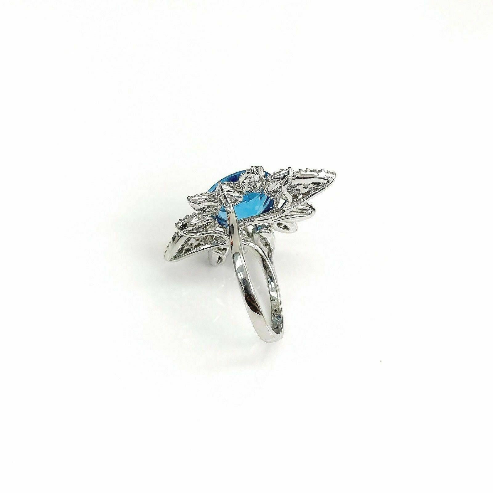 11.42 Carats tw Diamond and Blue Topaz Celebration Ring Topaz is 10 Carats 18K