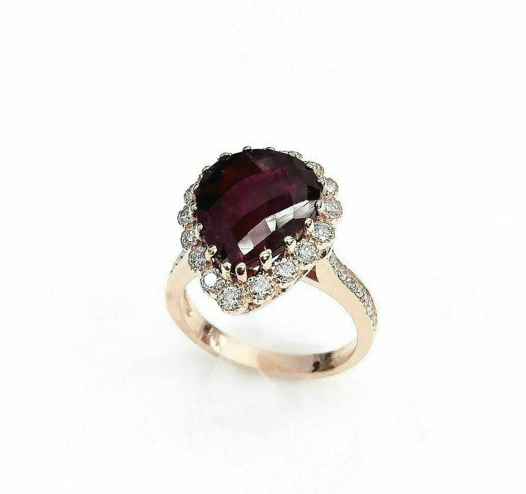 6.49 Carats t.w. Diamond and Ruby Halo Ring Ruby is 5.48 Carats 14K Rose Gold