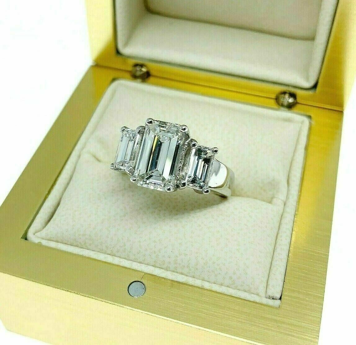 3.18 Carats t.w. 3 Stone Emerald Cut Diamond Wedding Ring GIA 2.02 H VVS2 Center