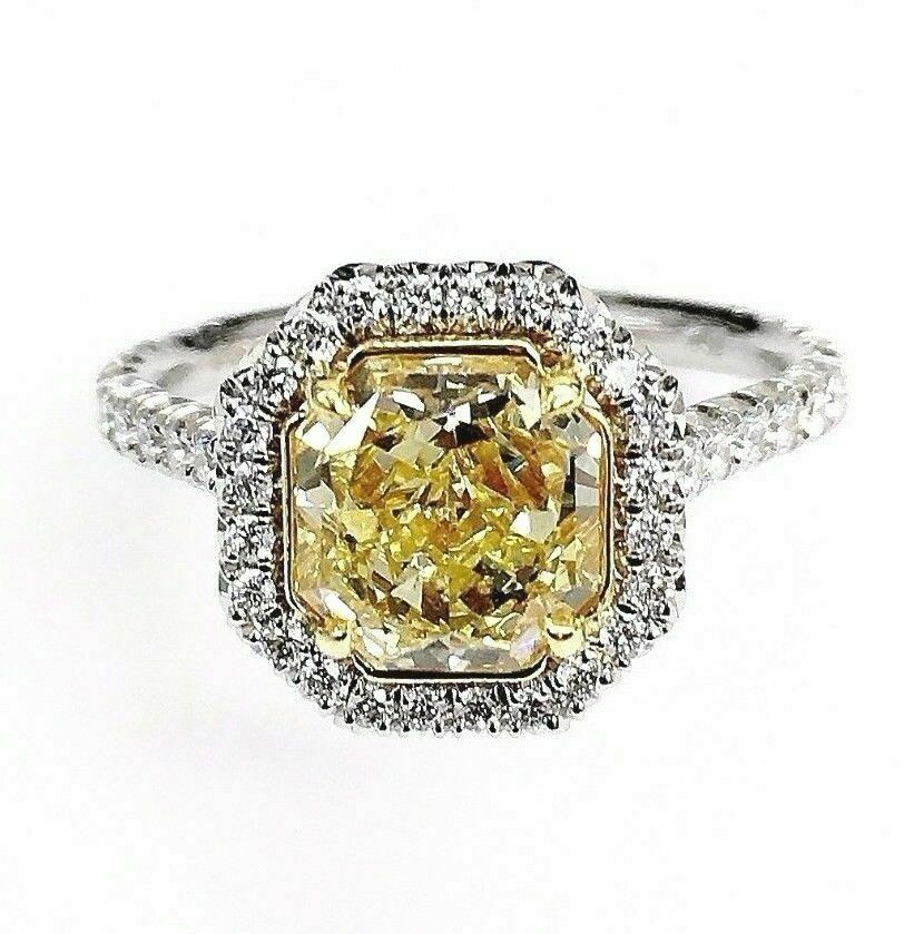 2.02 Carats GIA Fancy Intense Yellow VS2 Halo Diamond Ring 2.62 Carats t.w. New