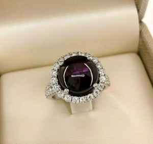 6.05 Carats Diamond and Cabochon Ruby Halo Ring Ruby is 5.07 Carats 14K Gold